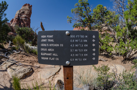 national parks: Sign pointing to locations in Canyonlands National Parks Stock Photo