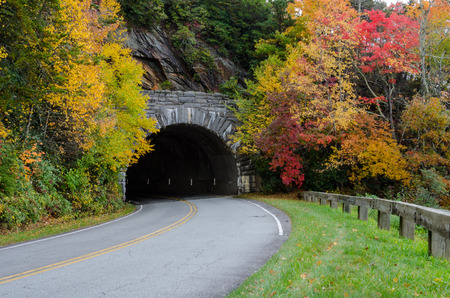 Leaves change around a stone tunnel on the Blue Ridge Parkway