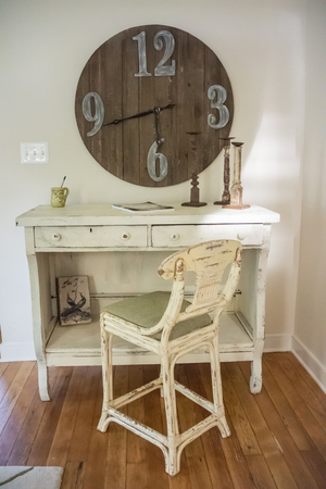 wooden clock: A vintage desk and chair with wooden clock