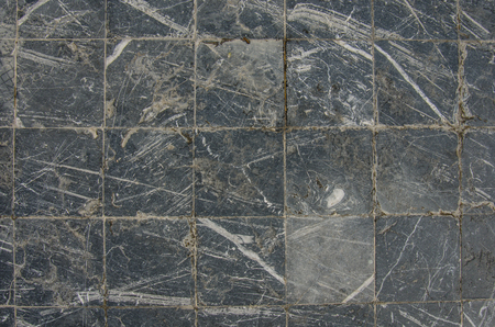 scratched: Scratched marble tiles in an outdoor plaza