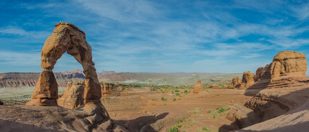 A panoramic shot of Delicate Arch and its surrounding canyon Stock fotó