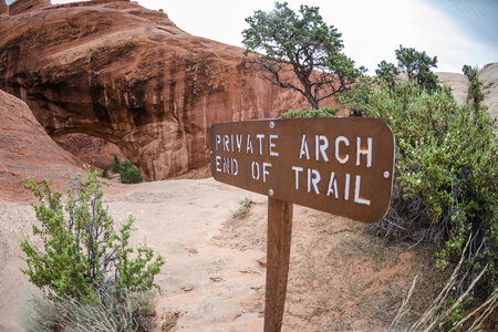 end of the trail: A fisheye view of the Private Arch and sign noting end of trail