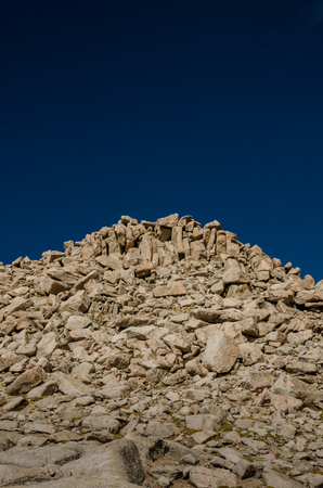 mount evans: A boulder field at the top of Mount Evans, one of Colorados peaks over 14,000 feet