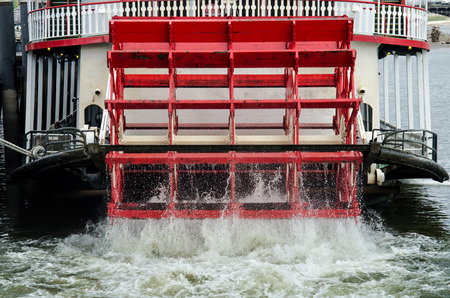 water wheel: A red water wheel churns in the Mississippi River