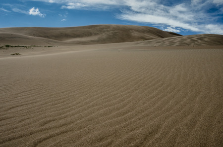 ridge of wave: Waves of ripples in a vast expanse of sand dunes
