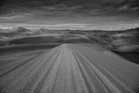 stretch out: Variant shades of sand stretch out across a vast expanse of sand dunes Stock Photo