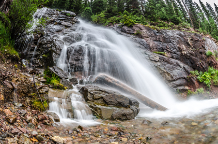 pine creek: A waterfall from snow melt taken with a fisheye lens on a hike near Gunnison Colorado