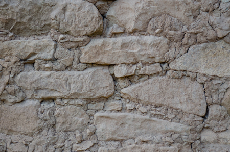 A background image of stone walls at the Mesa Verde ruins