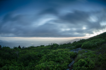 appalachian trail: A long exposure captures the brush and skies moving across Jane Bald near the Appalachian Trail