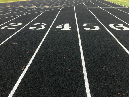 starting line: Numbers on a black track just behind the starting line