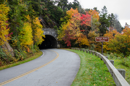 guard rail: Rough Ridge Tunnel with Sign in Autumn along the Blue Ridge Parkway