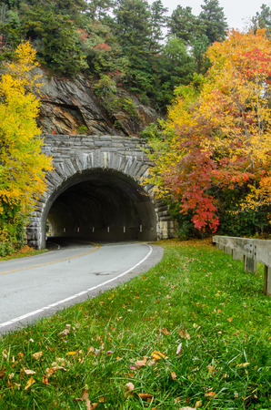guard rail: Rough ridge tunnel vertical in fall along a popular stretch of the Blue Ridge parkway