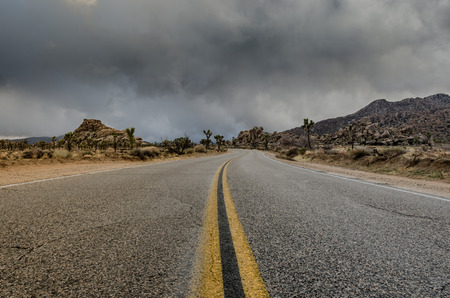 wintery day: Middle of desert road just before a storm rolls in on a wintery day during El Nino
