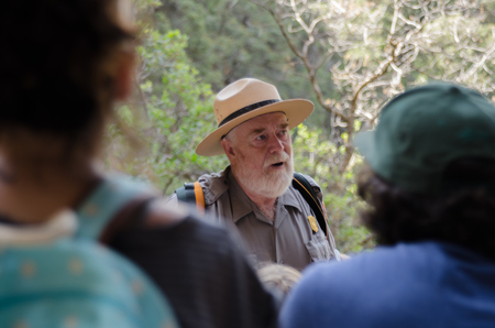 Mesa Verde National Park, United States- July 4, 2015: A National Park Service ranger educates tourists about the ruins of Mesa Verde on a guided tour