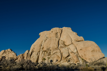 Monolith: Climbing a monolith on a clear day in a California desert Stock Photo