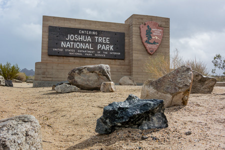 joshua tree national park: Joshua Tree, United States: January 31, 2016. Joshua Tree National Park Entry Sign on a rainy day in an El Nino year