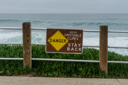 unstable: Danger unstable cliffs sign along the coast of the Pacific in southern California