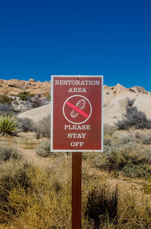visitors area: Restoration area sign vertical reminds visitors not to disturb the fragile terrain Stock Photo
