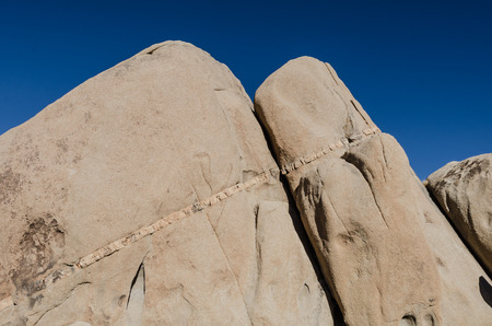 sandstone: Seam of rock in sandstone with deep blue sky on a clear day in Southern California