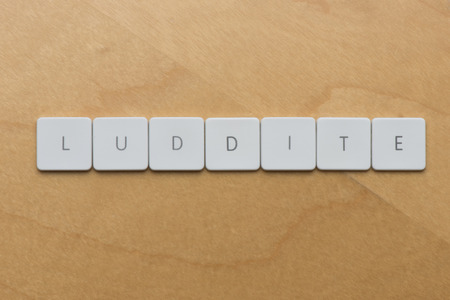 Keyboard Letters spell luddite, a name often used to refer to people who are slow to adopt new technology Zdjęcie Seryjne