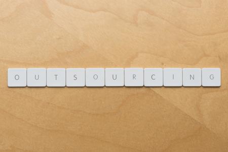 Keyboard letters spell outsourcing Zdjęcie Seryjne