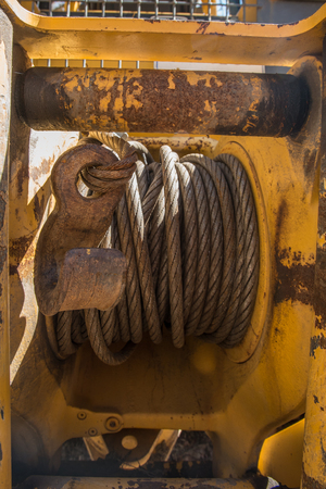 winch: Winch and hook on back of bulldozer