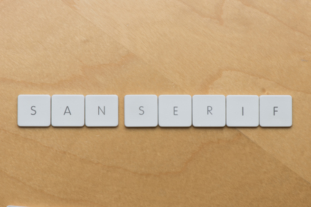 serif: Keyboard letters spell san serif, a type of font without embellishment Stock Photo