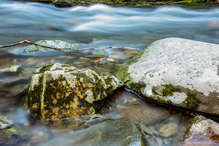 great smoky mountains national park: Snow melt rushing past mossy boulders in a creek in the Great Smoky Mountains National Park