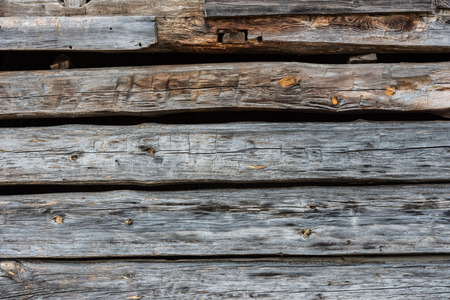 log wall: Hand hewn log wall of aged wood background image
