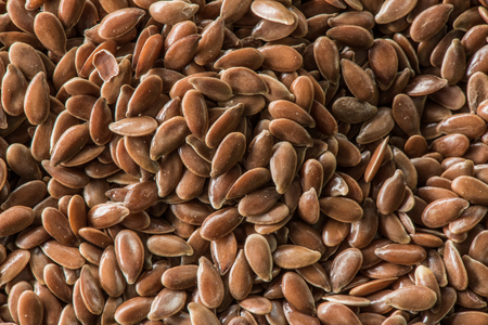 Close up of brown flax seed background image