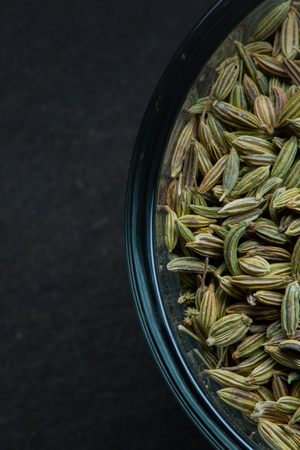 fennel seed: Cropped Fennel Seed Bowl Right with slate cutting board background Stock Photo