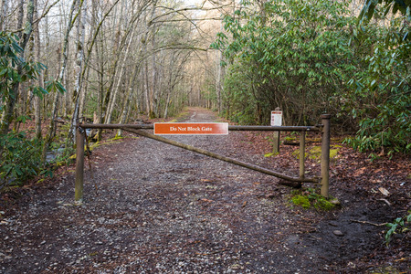 great smoky national park: Do Not Block Gate Sign over trail in Great Smoky Mountains National Park