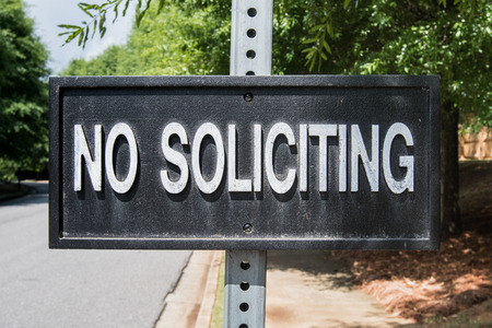 suburban neighborhood: No Soliciting Sign in suburban neighborhood