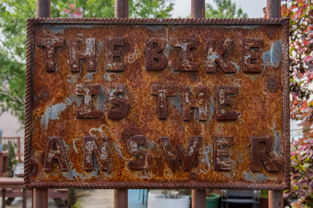 answer: The Bike is the Answer Rusted Sign on rusted fence