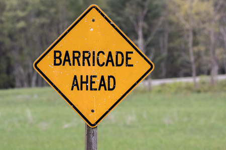 barricade: Yellow Barricade Ahead Sign worn with weather