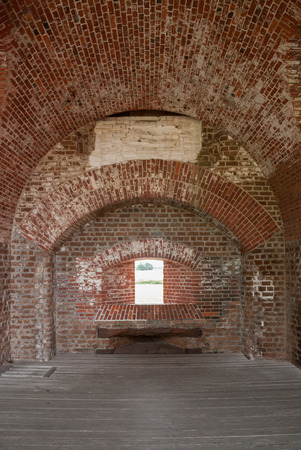 worn structure red: Arches and window formed of brick in a civil war era fort