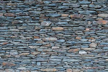 tightly: Tightly Stacked Small Stone Wall background image