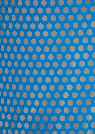blue bin: Uniform Punched Holes in Blue Metal Bin background image