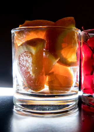 bar top: Oranges for Drinks Backlit on a bar top Stock Photo