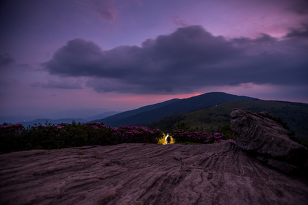 jane: Hikers Descend Jane Bald at Civil Twilight with purple sunset lingering over mountain