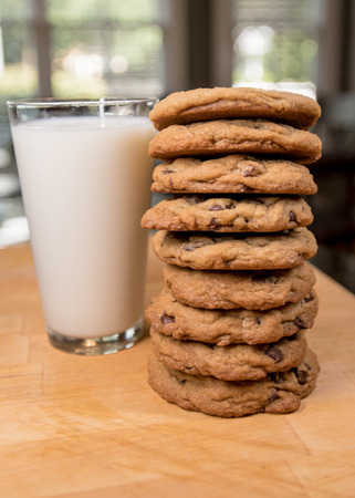Stack of Cookies and Milk on butcher block counter