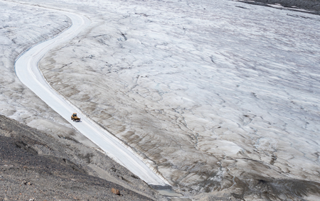 maintains: Tractor Maintains Ice Road on Athabasca Glacier