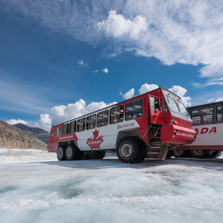 icefield: Jasper, Canda. June 28th, 2016. Ice explorer buses take tourists out to view the Athabasca Glacier and Columbia Icefield Editorial