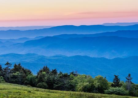 Hazy Blue Ridge Mountains at Sunset with grass bald in foreground Standard-Bild