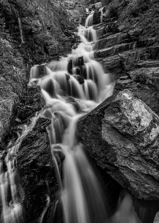 rock creek: Alder Creek Falls Black and White tumbling over a rock cliff