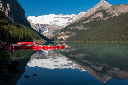 louise: Lake Louise and Red Canoes with mountain reflection