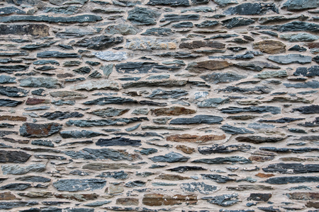 grout: Brown and Slate Stone Wall with tan cement grout Stock Photo