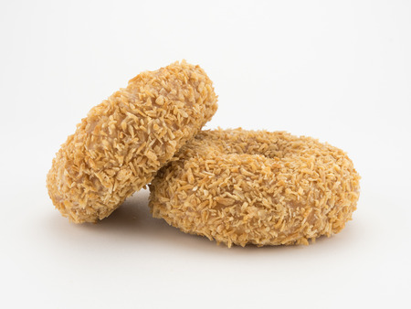 toasted: Donuts Two with toasted coconut on White