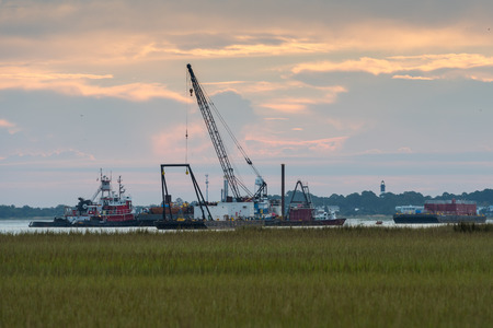tybee island: October 2, 2016: Tybee Island, United States: Dredging Crew on Tybee Island clears debris from the channel to let the water remain deep Editorial
