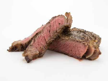 Steak slices from a ribeye isolated on a white background Stock Photo